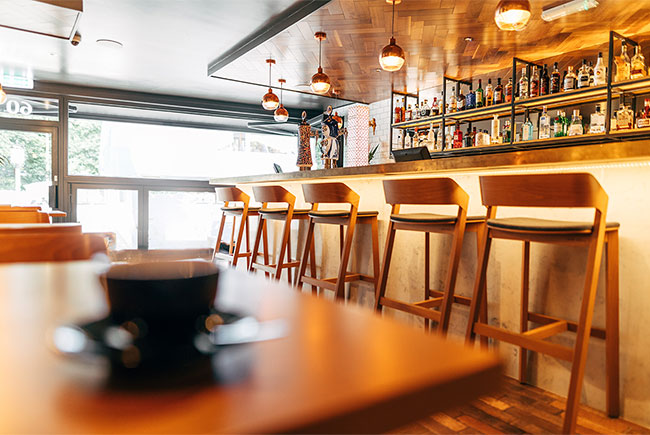 Beautifully crafted bar with sophisticated palette of materials has become a destination place for locals and tourists.