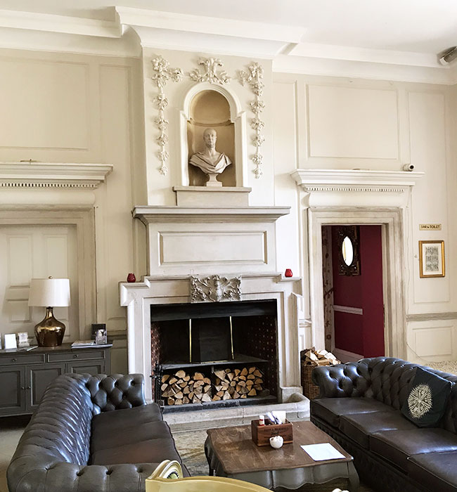 historic hotel fireplace with seating