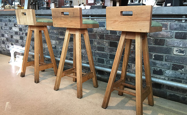 small batch coffee chairs by the counter